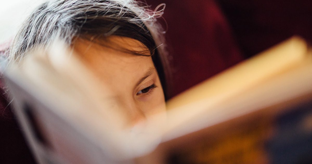 child reading a book featured